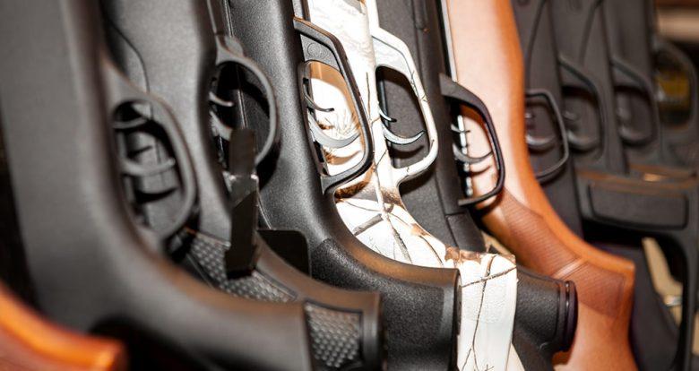 rack of rifles and shotguns